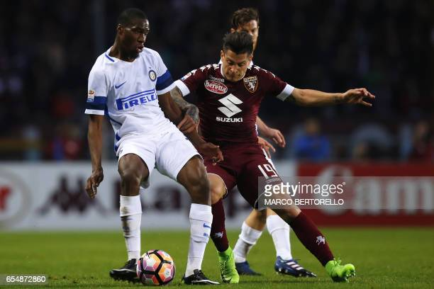 Inter Milan's French midfielder Geoffrey Kondogbia vies with Torino's Argentinian forward Juan Manuel Iturbe during the Italian Serie A football...