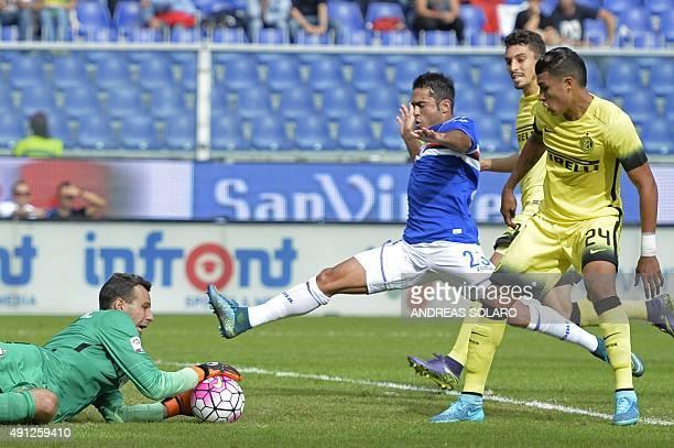 Inter Milan's goalkeeper from Slovenia Samir Handanovic makes a save in front of Sampdoria's forward from Italy Eder the Italian Serie A football...