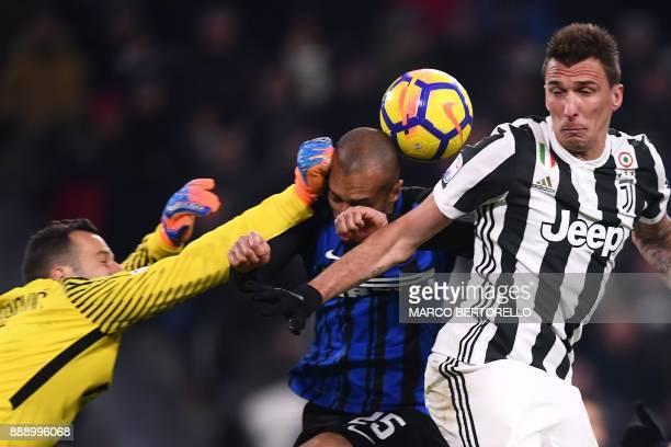 Inter Milan's goalkeeper Samir Handanovic from Slovenia and Inter Milan's defender Joao Miranda de Souza Filho from Brazil fight for the ball with...