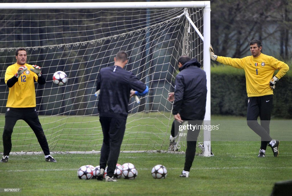 http://media.gettyimages.com/photos/inter-milans-goalkeepers-julio-cesar-and-francesco-toldo-take-part-in-picture-id90792027