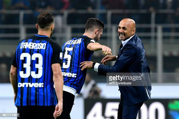Inter Milan's Italian coach Luciano Spalletti celebrates with players Danilo D'ambrosio and Roberto Gagliardini after winning the Italian Serie A...