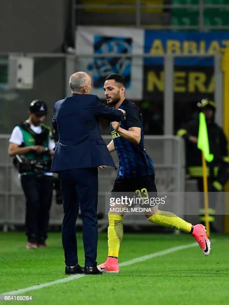 Inter Milan's Italian defender Danilo D'Ambrosio celebrates with Inter Milan's Italian coach Stefano Pioli after scoring a goal during the Italian...