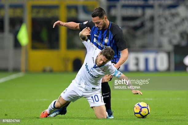 Inter Milan's Italian defender Danilo D'Ambrosio tackles Atalanta's Argentinian forward Alejandro Gomez during the Italian Serie A football match...