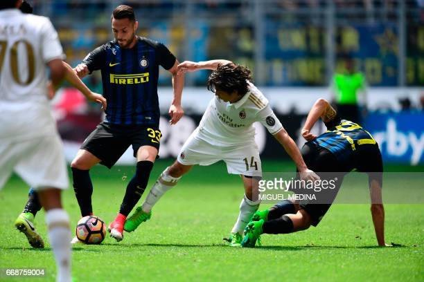 Inter Milan's Italian defender Danilo D'Ambrosio vies with AC Milan's Chilian midfielder Mati Fernandez during the Italian Serie A football match...