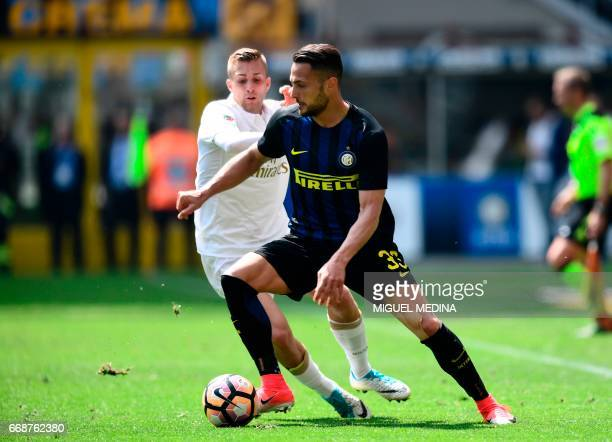 Inter Milan's Italian defender Danilo D'Ambrosio vies with AC Milan's Spanish forward Gerard Deulofeu during the Italian Serie A football match Inter...