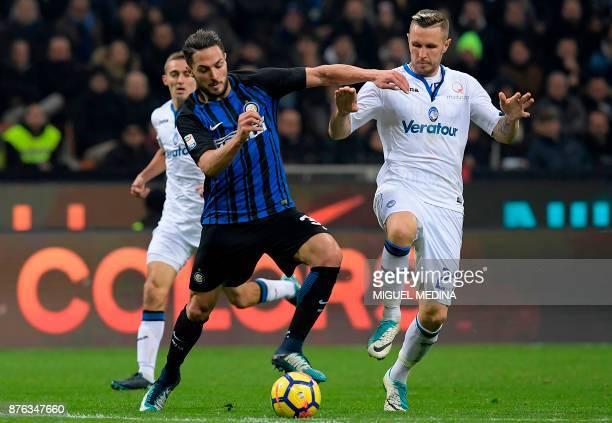 Inter Milan's Italian defender Danilo D'Ambrosio vies with Atalanta's Slovenian midfielder Jasmin Kurtic during the Italian Serie A football match...