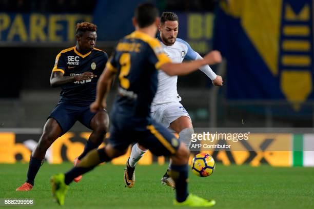 Inter Milan's Italian defender Danilo D'Ambrosio vies with Hellas Verona's Italian forward Moise Kean and Hellas Verona's Brazilian midfielder Romulo...