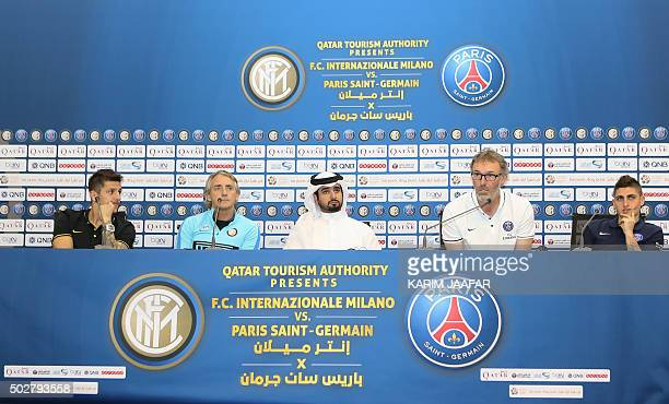 Inter Milan's Italian head coach Roberto Mancini and his striker Stevan Jovetic from Montenegro attend a press conference with Paris SaintGermain's...