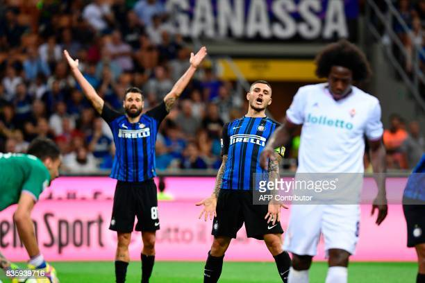Inter Milan's Italian midfielder Antonio Candreva and Inter Milan's Argentinian forward Mauro Icardi react during the Italian Serie A football match...