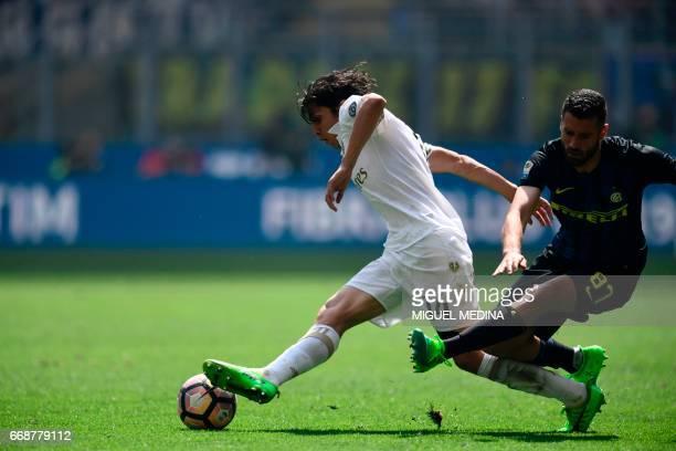 Inter Milan's Italian midfielder Antonio Candreva vies with AC Milan's Chilean midfielder Mati Fernandez during the Italian Serie A football match...