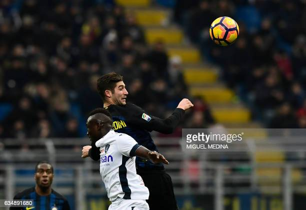 TOPSHOT Inter Milan's Italian midfielder Roberto Gagliardini and Empoli's Senegalese forward Assane Diousse vies for the ball during the Serie A...
