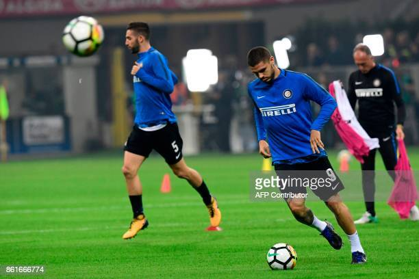 Inter Milan's Italian midfielder Roberto Gagliardini and Inter Milan's Captain Argentinian forward Mauro Icardi warm up before the Italian Serie A...