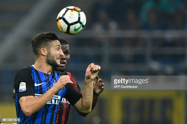 Inter Milan's Italian midfielder Roberto Gagliardini vies with AC Milan's Ivorian midfielder Franck Kessie during the Italian Serie A football match...