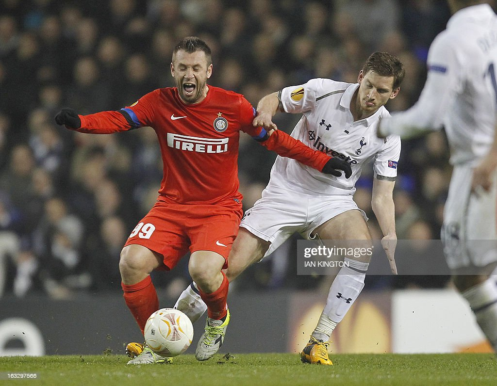 Inter Milan's Italian striker Antonio Cassano (L) vies for the ball against Tottenham Hotspur's Belgian footballer Jan Vertonghen during a UEFA Europa League Round of 16 football match between Tottenham Hotspur and Inter Milan at White Hart Lane in east London, on March 7, 2013.