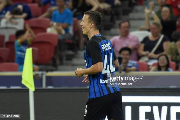 Inter Milan's Ivan Perisic reacts after scoring against Chelsea during their International Champions Cup football match in Singapore on July 29 2017...