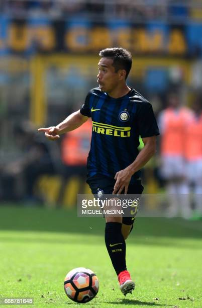 Inter Milan's Japanese defender Yuto Nagatomo controls the ball during the Italian Serie A football match Inter Milan vs AC Milan at 'San Siro'...