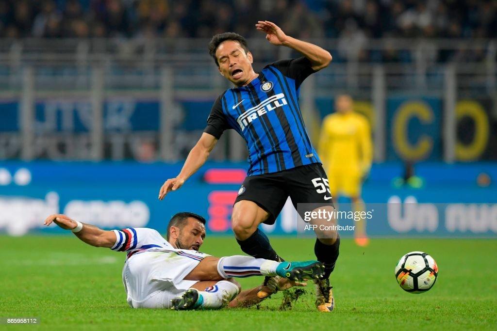 Inter Milan's Japanese defender Yuto Nagatomo (R) is tackled by Sampdoria's Italian midfielder Fabio Quagliarella during the Italian Serie A football match Inter Milan vs Sampdoria at the San Siro stadium in Milan on October 24, 2017. /