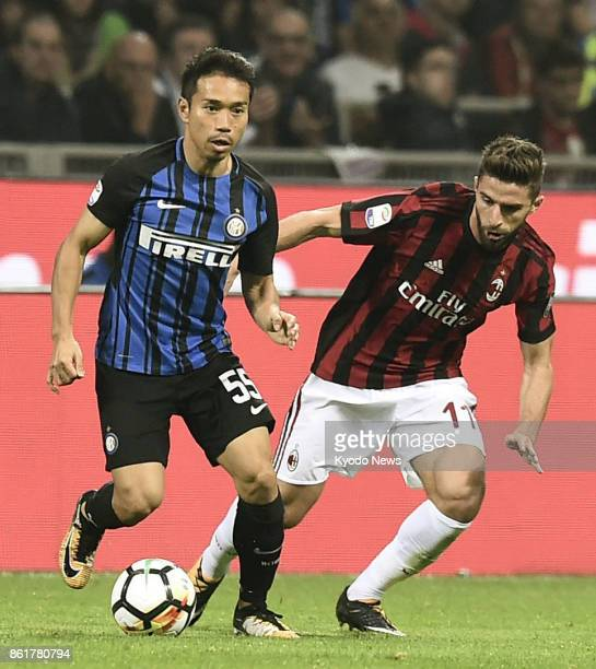 Inter Milan's Japanese defender Yuto Nagatomo keeps the ball away from AC Milan forward Fabio Borini in a 32 victory in the Italian Serie A at the...