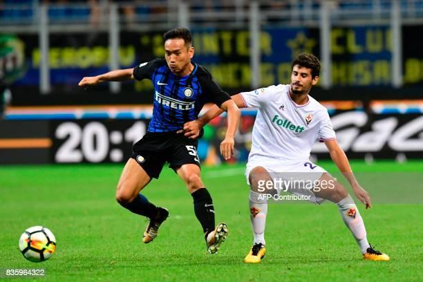 Inter Milan's Japanese defender Yuto Nagatomo vies with Fiorentina's Portuguese midfielder Gil Dias during the Italian Serie A football match Inter...