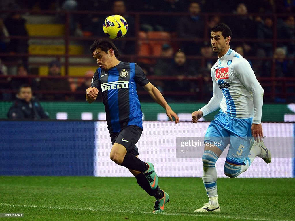 Inter Milan's Japanese midfielder Yuto Nagatomo (L) fights for the ball with Uruguayan Napoli's defender Angel Miguel Britos during the Italian serie A football match between Inter MIlan and Napoli on December 9, 2012 at the San Siro stadium in Milan. AFP PHOTO / OLIVIER MORIN