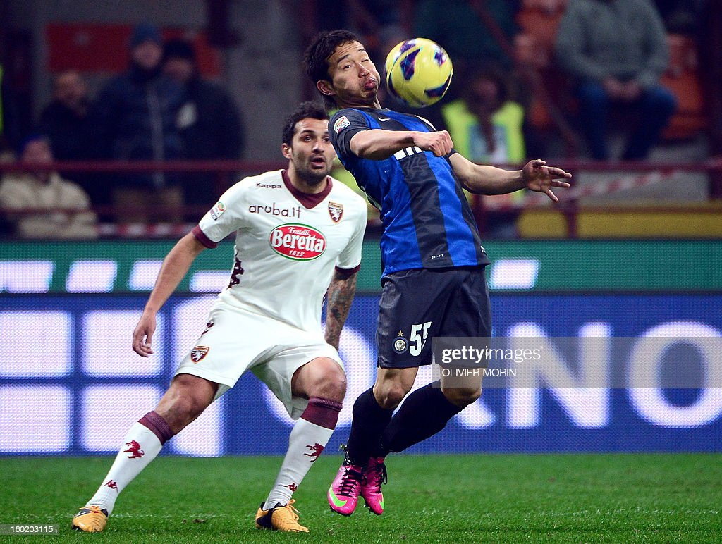 Inter Milan's Japanese midfielder Yuto Nagatomo (R) fights for the ball with Torino's goalkeeper Lys Gomis Torino's midfielder Matteo Brighi during the serie A match Inter Mlan vs Torino, on January 27, 2013 at the San Siro stadium in Milan.
