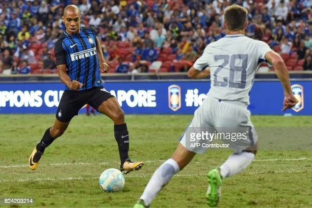 Inter Milan's Joao Mario attempts a shot on goal against Chelsea during their International Champions Cup football match in Singapore on July 29 2017...