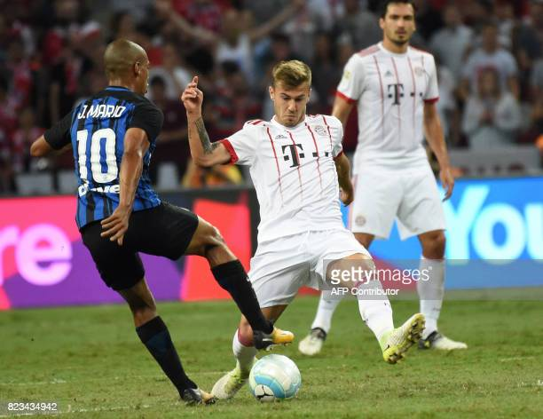 Inter Milan's Joao Mario fights for the ball with Bayern Munich's Niklas Dorsch during their International Champions Cup football match in Singapore...