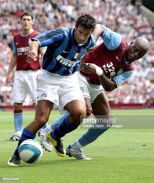 Inter Milan's Luis Figo battles with Aston Villa's Nigel ReoCoker during a Pre Season Friendly at Villa Park Birmingham