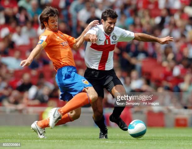 Inter Milan's Luis Figo battles with Valencia's David Albelda during the Emirates Cup match at the Emirates Stadium London
