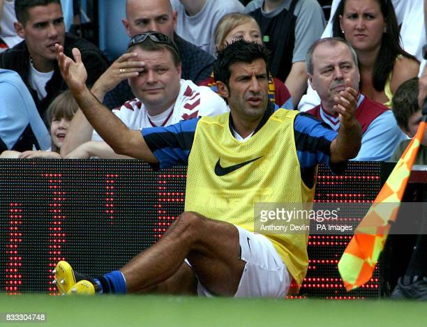 Inter Milan's Luis Figo watches and gestures from the touchline during a Pre Season Friendly at Villa Park Birmingham