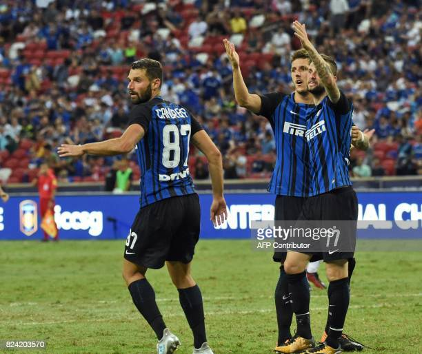 Inter Milan's MarceloBrozovic reacts with his teammates react after the referee disallowed a goal against Chelsea during their International...