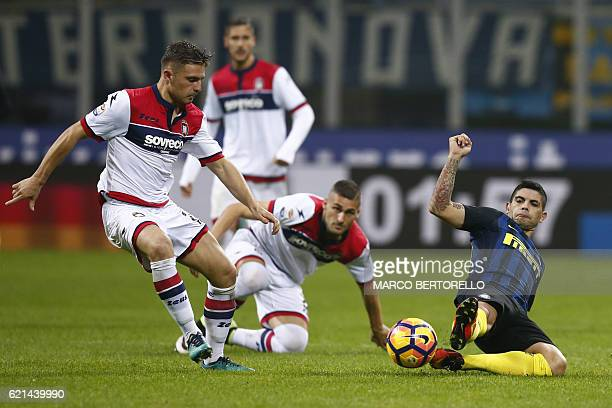 Inter Milan's midfielder Ever Banega of Argentina fights for the ball with Crotone's forward Adrian Marius Stoian of Romania during the Italian Serie...