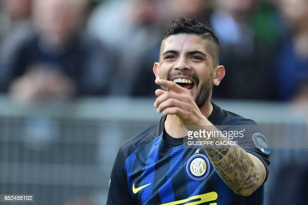 Inter Milan's midfielder from Argentina Ever Banega celebrates after scoring during the Italian Serie A football match Inter Milan vs Atalanta at...