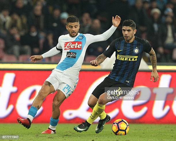 Inter Milan's midfielder from Argentina Ever Banega fights for the ball with Napoli's forward from Italy Lorenzo Insigne during the Italian Serie A...