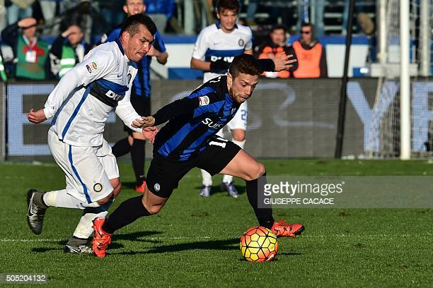 Inter Milan's midfielder from Chile Gary Medel fights for the ball with Atalanta's midfielder from Argentina Alejandro Gomez the Italian Seria A...