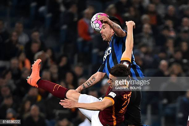 Inter Milan's midfielder from Chile Gary Medel vies with Roma's forward from Italy Stephan El Shaarawy during the Italian Serie A football match...