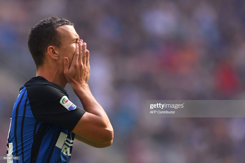 Inter Milan's midfielder from Croatia Ivan Perisic reacts during the Italian Serie A football match Inter Milan vs Genoa at San Siro stadium in Milan on September 24, 2017. /