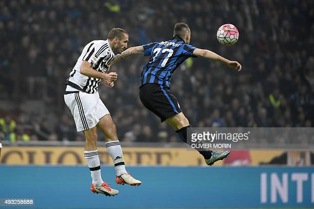 Inter Milan's midfielder from Croatia Marcelo Brozovic fights for the ball with Juventus' defender from Italy Giorgio Chiellini during the Italian...