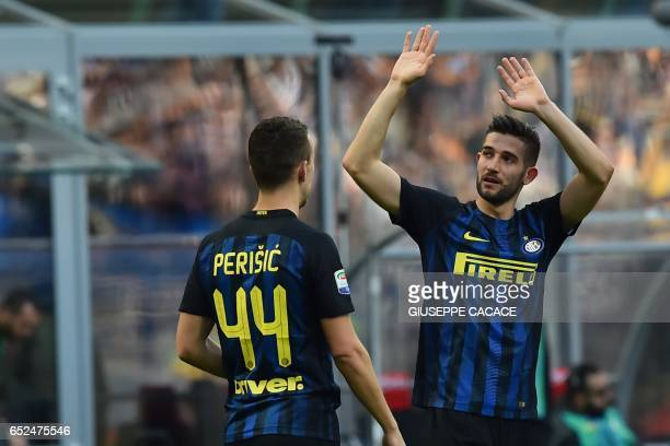 Inter Milan's midfielder from Italy Roberto Gagliardini celebrates after scoring a goal during the Italian Serie A football match Inter Milan vs...