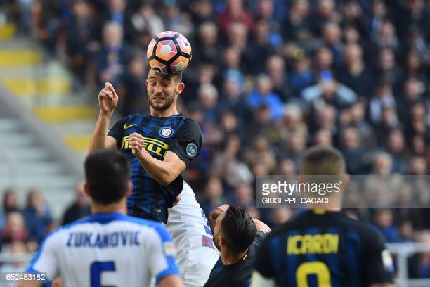 Inter Milan's midfielder from Italy Roberto Gagliardini heads the ball during the Italian Serie A football match Inter Milan vs Atalanta at 'San...