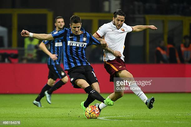 Inter Milan's midfielder from Montenegro Stevan Jovetic fights for the ball with Roma's Greek defender Kostas Manolas during the Italian Serie A...
