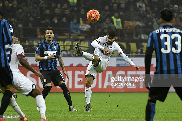 Inter Milan's midfielder from Montenegro Stevan Jovetic fights for the ball with Genoa's midfielder from Venezuela Tomas Rincon during the Italian...