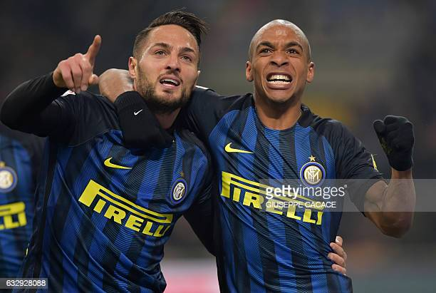 Inter Milan's midfielder from Portugal Joao Mario celebrates after scoring a goal with Inter Milan's defender from Italy Danilo D'Ambrosio during the...