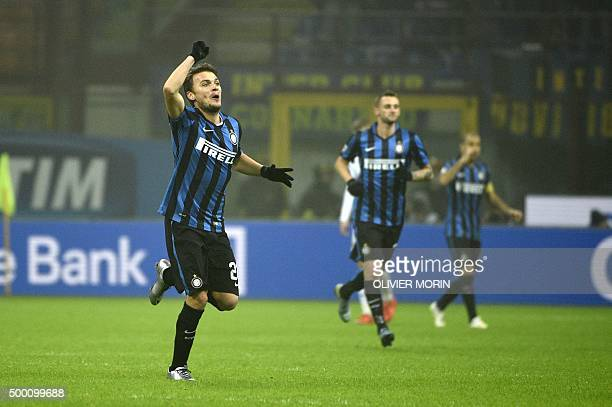 Inter Milan's midfielder from Serbia Adem Ljajic celebrates after scoring during the Italian Serie A football match Inter Milan vs Genoa on December...
