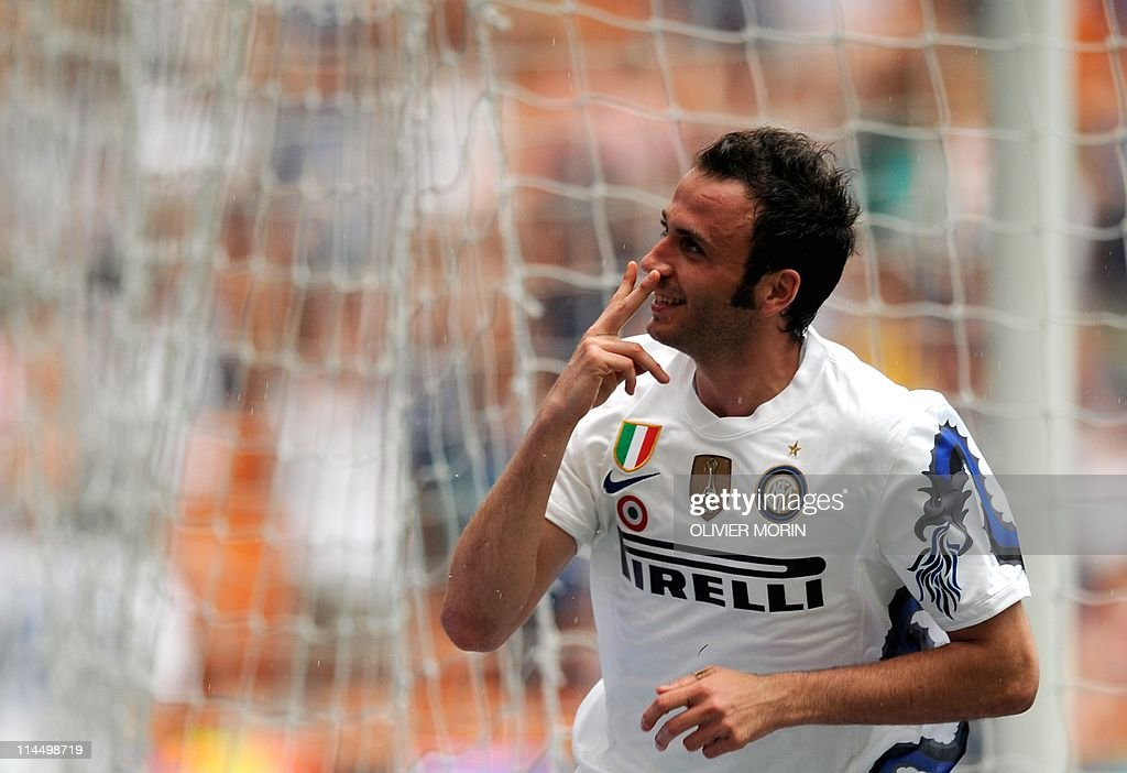 Inter Milan's midfielder Giampaolo Pazzini celebrates after scoring during their serie A match Inter against Fiorentina, on May 22, 2011 at the San Siro stadium in Milan.