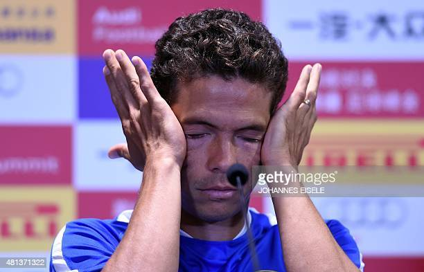Inter Milan's midfielder Hernanes gestures during a press conference one day ahead the friendly football match between Bayern Munich and Inter Milan...