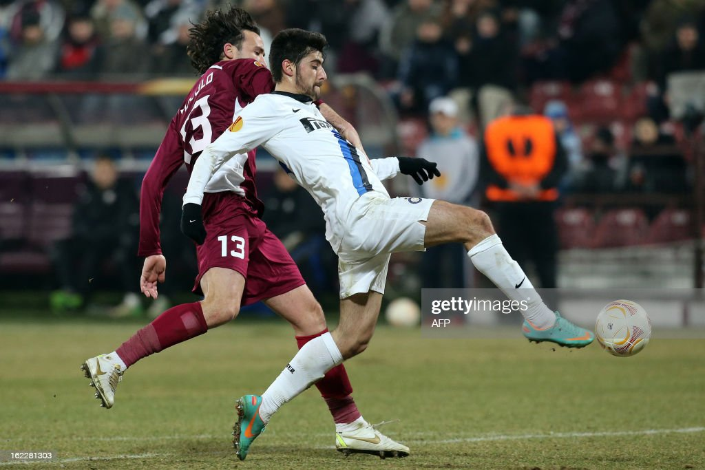 Inter Milan's midfielder Marco Benassi (R) celebrate scores after challenging Cluj's Italian defender Felice Piccolo (L) during the UEFA Europa League Round of 32 football match CFR 1907 Cluj vs Inter Milan in Cluj, northern Romania on February 21, 2013. Inter Milan won the mach 0-3. AFP PHOTO / MIRCEA ROSCA