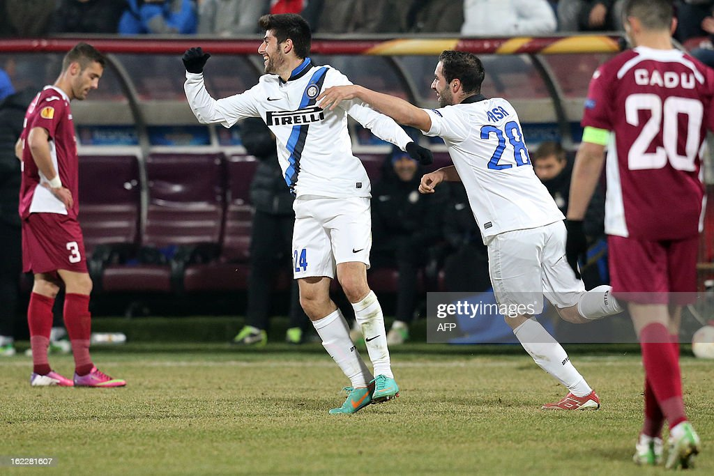 Inter Milan's midfielder Marco Benassi (2nd L) celebrates after scoring with his teammate Simone Pasa during the UEFA Europa League Round of 32 football match CFR 1907 Cluj vs Inter Milan in Cluj, northern Romania on February 21, 2013. AFP PHOTO / MIRCEA ROSCA