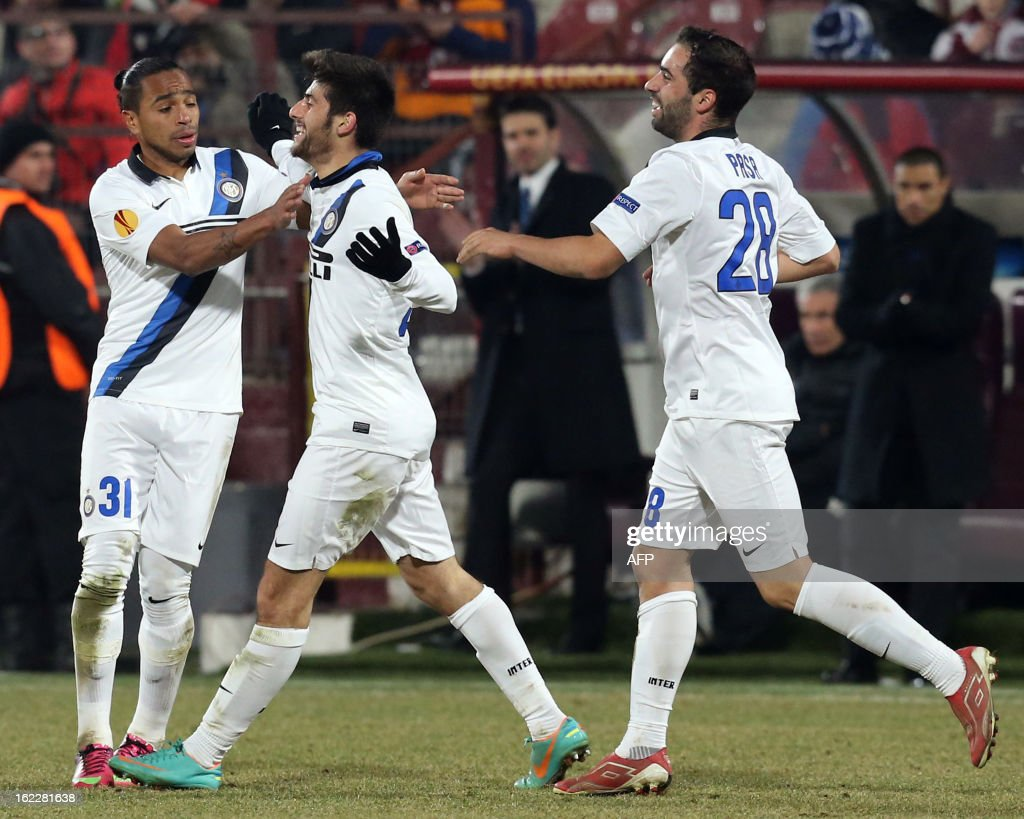 Inter Milan's midfielder Marco Benassi (C) celebrates after scoring with his teammate Simone Pasa (R) and midfielder of Uruguay Alvaro Pereira during the UEFA Europa League Round of 32 football match CFR 1907 Cluj vs Inter Milan in Cluj, northern Romania on February 21, 2013. AFP PHOTO / MIRCEA ROSCA