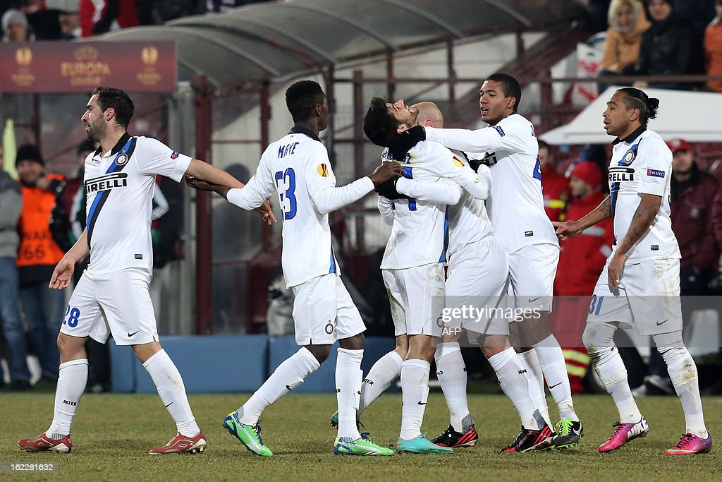 Inter Milan's midfielder Marco Benassi (C) celebrates with his teammates after scoring during the UEFA Europa League Round of 32 football match CFR 1907 Cluj vs Inter Milan in Cluj, northern Romania on February 21, 2013. Inter Milan won the match 0-3. AFP PHOTO / MIRCEA ROSCA